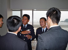 Participants in relaxed conversation with cadets
