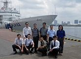 Group photo in front of the reviewing ship